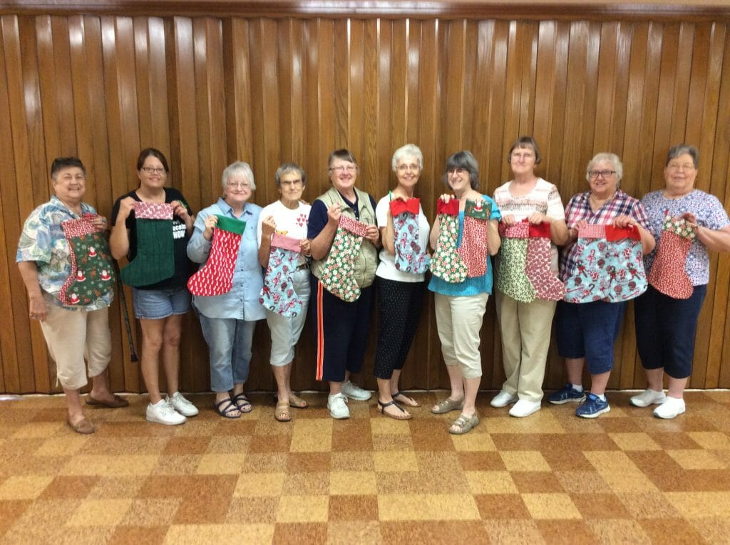 Women at Roseville Christian Church show off their Stockings of Joy